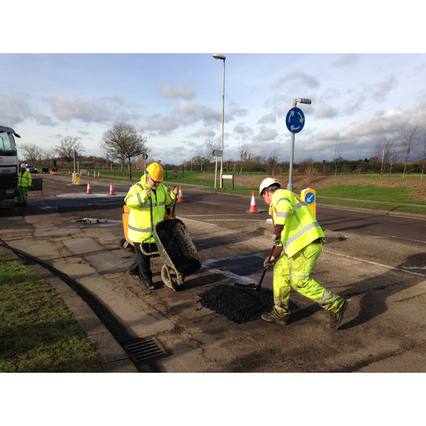 Dave Hodgson lending a hand on site during pothole repair work on Wentworth Drive in Bedford