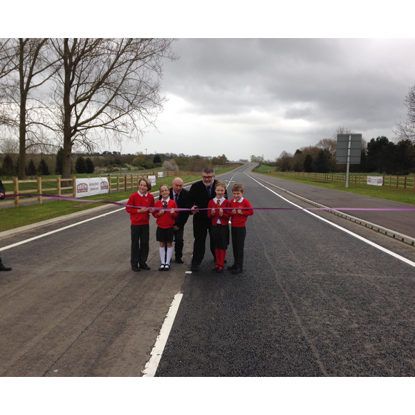 Mayor Dave Hodgson, John Breheny and Children from St James School in Biddenham mark the opening of the final section of the Bedford Western Bypass