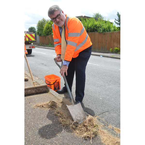 Mayor Dave Hodgson Helping to Clear the Weeds from the Highways