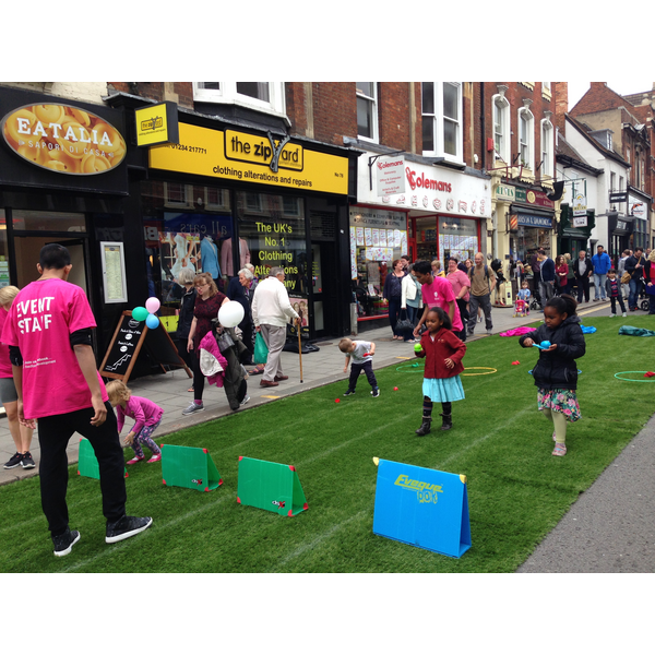 Children Enjoying the Egg and Spoon Race at Bedford's Big High Street Showcase
