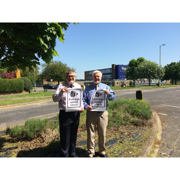 Mayor Dave Hodgson and Deputy Mayor Cllr Charles Royden with Average Speed Camera Signs on Polhill Avenue, Bedford