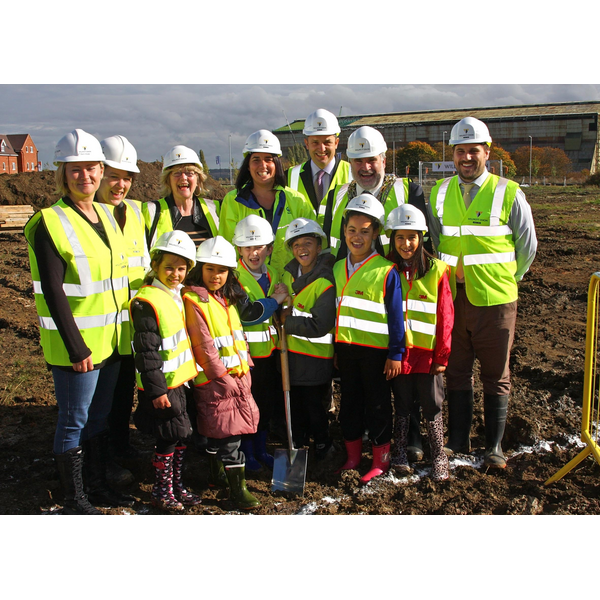 Dave Hodgson with children from Shortstown Lower School and Others Assembled for the turning of the first sod at the site of the new Shortstown Primary School