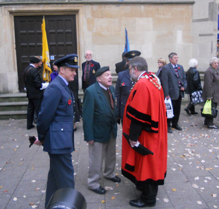 Mayor Dave Hodgson with forces veterans following the Remembrance Service at Boots Corner in Bedford