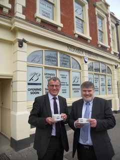 Mayor Dave Hodgson with Cllr Doug McMurdo outside Number Thirteen, the new front of house cafe-bar for Bedford Corn Exchange