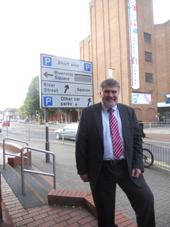 Mayor Dave Hodgson with the car parks sign on Horne Lane, Bedford