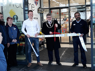 Mayor Dave Hodgson cuts the ribbon at the opening of the Lidl store on Goldington Road