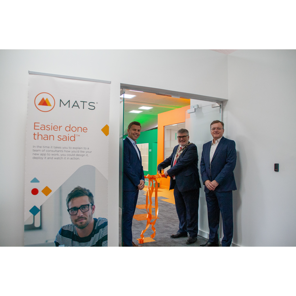 Mayor Dave Hodgson cuts the ribbon at the opening of MatsSoft's new offices at Bedford Heights